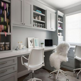 Home office with gift-wrapping and work space.