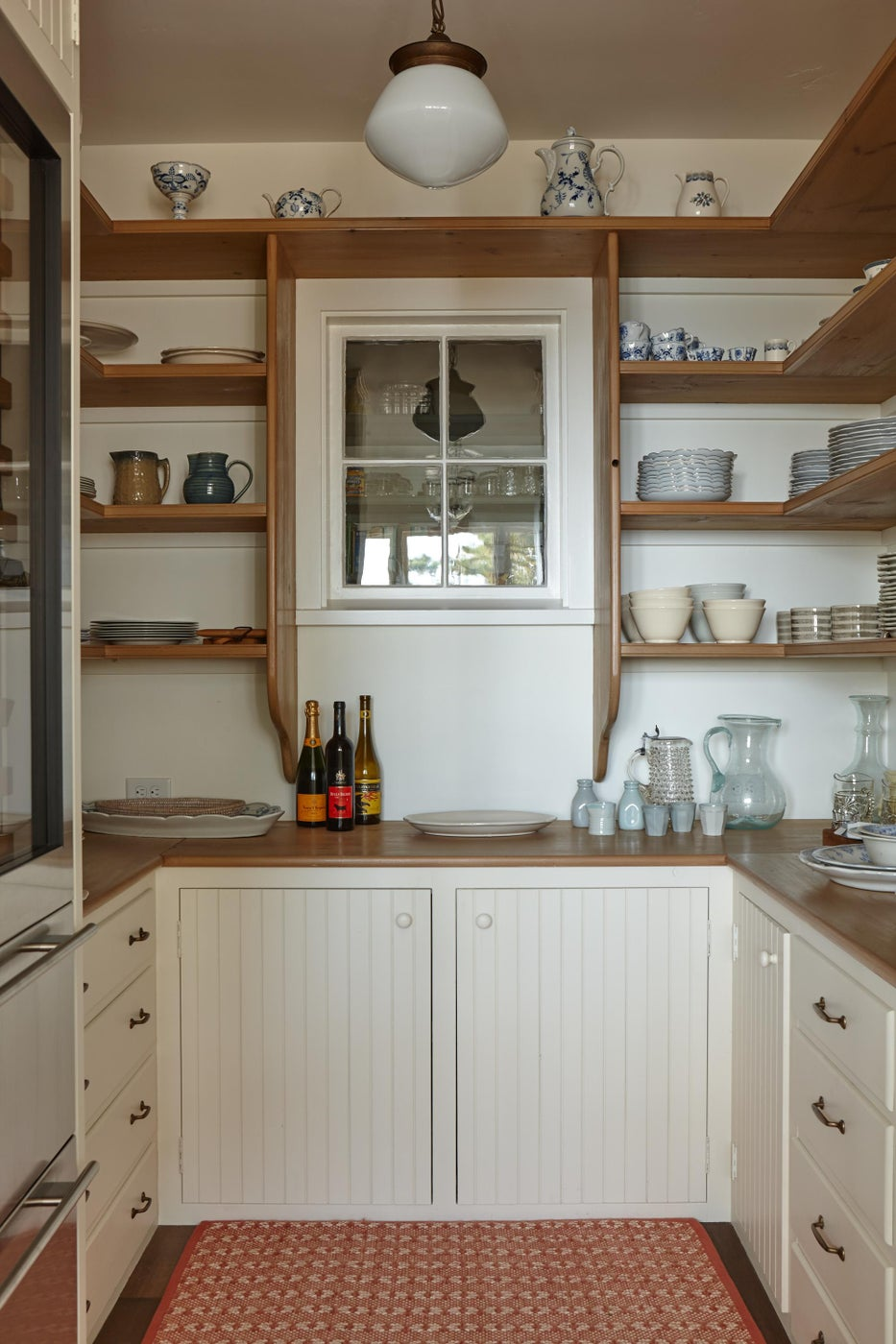 Pantry in kitchen with white cabinetry.