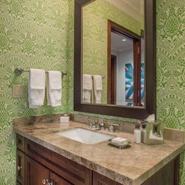Bath with Whimsical Green Pineapple Print Wallpaper
