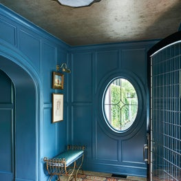 Deep marine blue entry foyer in North Shore home.