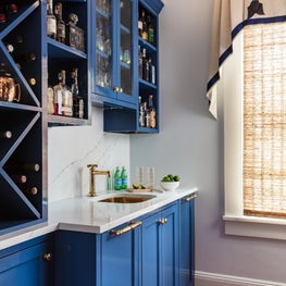 Custom designed blue bar and cabinetry in this historic Marthas Vineyard home.