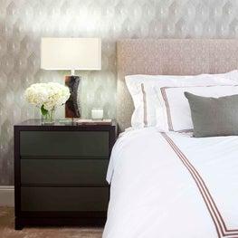 Shagreen Diamond Wallpaper by Brett Design, Inc adds flair to a neutral bedroom.