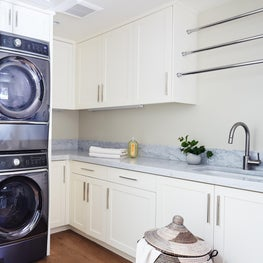 Clean and White Laundry Room