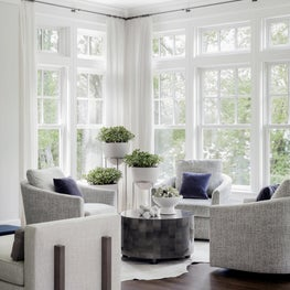 Great room seating area with neutral upholstery and blue accents