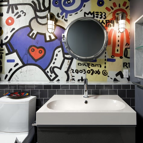 Fun teen bathroom with a graffiti mural.