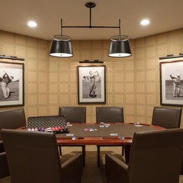 Golf-influenced Poker Room with rivet wallcovering and vintage golf photography.