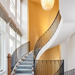 Deco Stair Hall with Gold Wallcovering, Checked Marble Tile, & Metal Balustrade