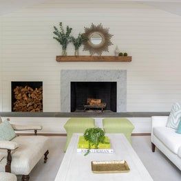A clean palette with pops of color in this subtle and fresh living room