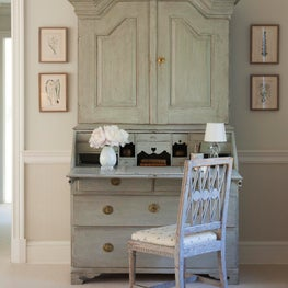 In the Master Bedroom is an antique Gustavian painted secretaire and chair