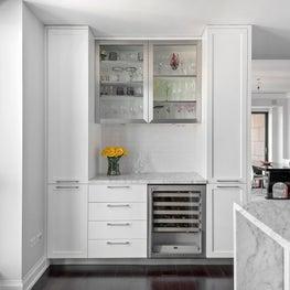 An all white modern & contemporary kitchen in Chicago's Waldorf Astoria.