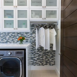 Laundry room with custom cabinets and gorgeous tile detail