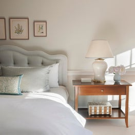 Master Bedroom with a serene color palette and custom upholstery