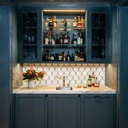 A handsome home bar. Designed by Lindsay Gerber.