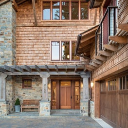 Shingle-style entry and driveway in California Arts & Crafts style