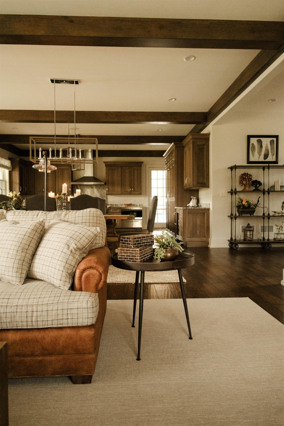 Great room accent table, sectional, rug, shelving, wood floor, beams