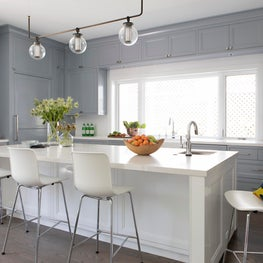 Gray and White kitchen with custom lighting fixture