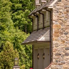 Traditional stone farmhouse garage entry