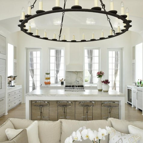 White washed wood cabinetry within plaster surrounds at Kitchen open to Living