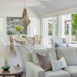 COASTAL LVING DINING WITH FOLDING DOORS TO THE OUTSIDE