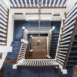 Square Stacked Staircase with Blue Runner, Chain Suspended Nickel Cage Pendant