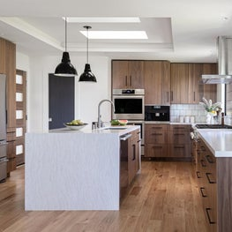 Contemporary Kitchen with Walnut Cabinetry and Waterfall Island