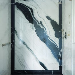 Zero clearance shower with black and white marble slab