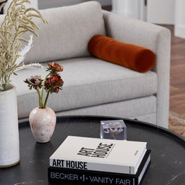 Minimalist Living Room Detail with Rust Accent & Marble Table