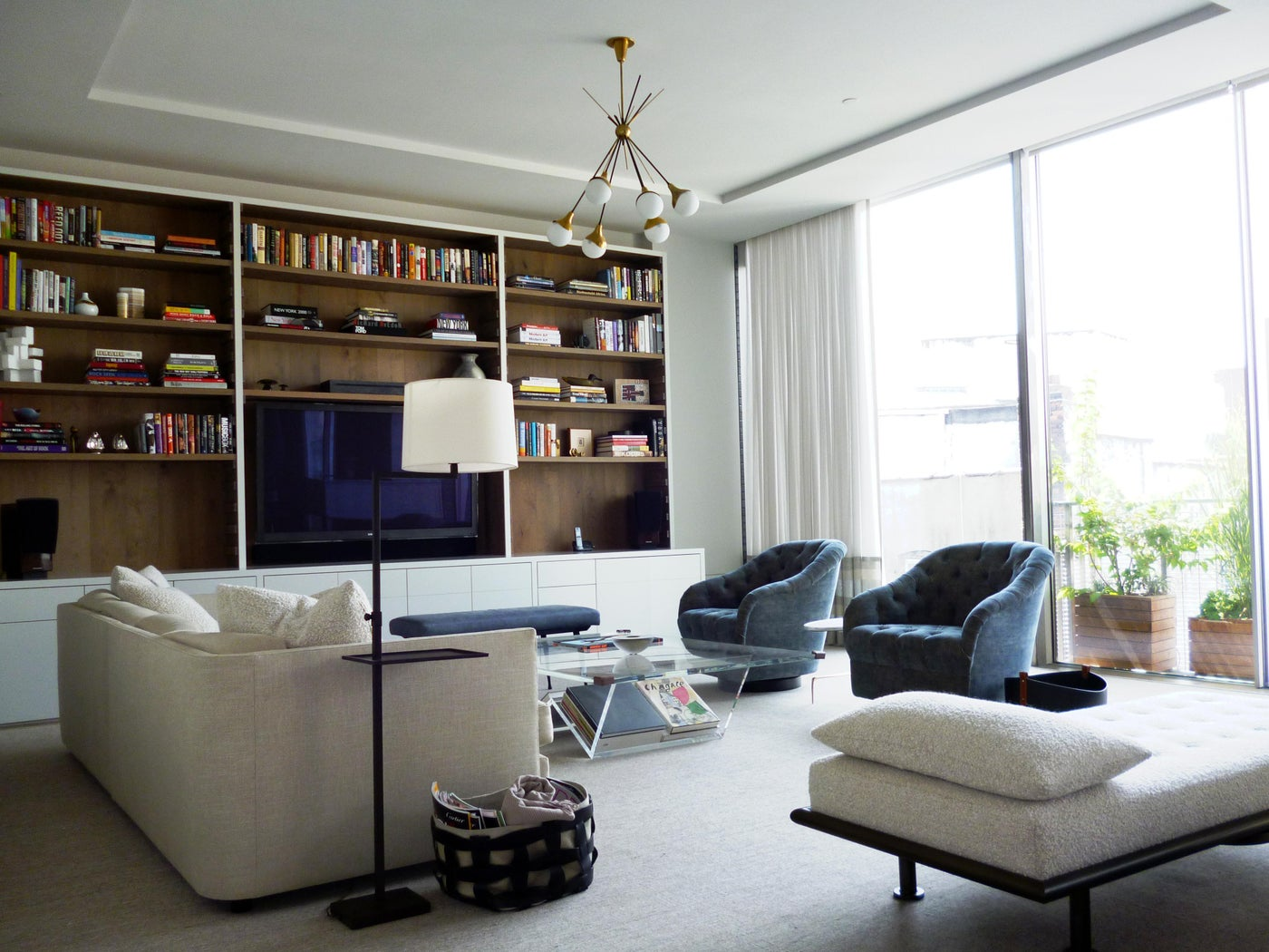 Minimal drapes ease into the background of this contemporary living room.