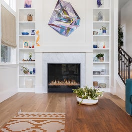 Above the mantle, a dynamic painting by Kevin Moore breaks the rectilinear space with bold geometry and a complementary color scheme. Also included, Eigenvector, a 3D sculpture by the artist