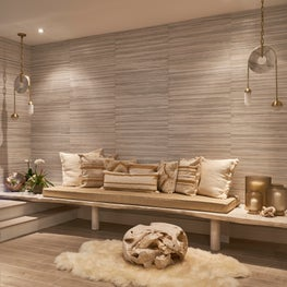 Versatile textures and patterns transformed this basement into a retreat.
