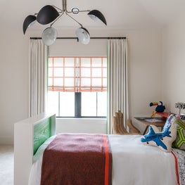Fun and colorful boys bedroom with youthful accents