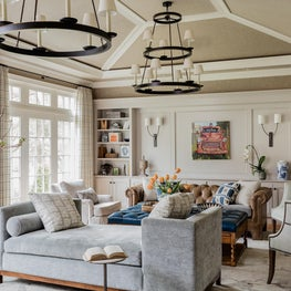 Neutral beige cream living room sunburst vaulted ceiling two-tier chandelier