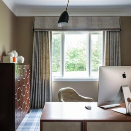 Home Office with plaid carpet, hand printed fabric, desk with leather insets.