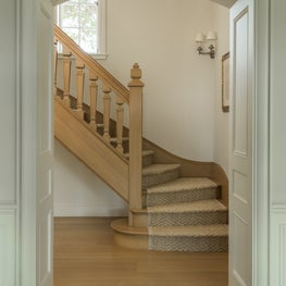 The main staircase includes period details and gently curves up from the foyer.