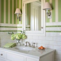 Contemporary farmhouse bathroom with sconces, green striped wallpaper