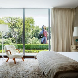 Iconic modern House on the Gold Coast of Long Island - master bedroom self lined brisby pleat with resessed tracks