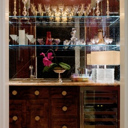 A closet-sized yet glamourous bar tucked off the home's main-floor hallway recreates the feel of a chic Parisian café and provides an escape from the everyday.