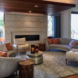 This living room needed an infusion of comfort, clad with natural materials.