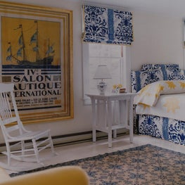Blue and White Bedroom with pops of yellow