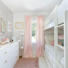 Girls room with bunk bed and trundle