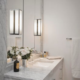 A guest bathroom in marble and white