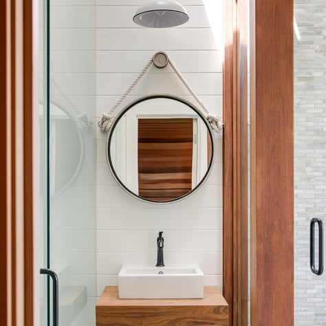 The pool house bathroom with free standing basin.