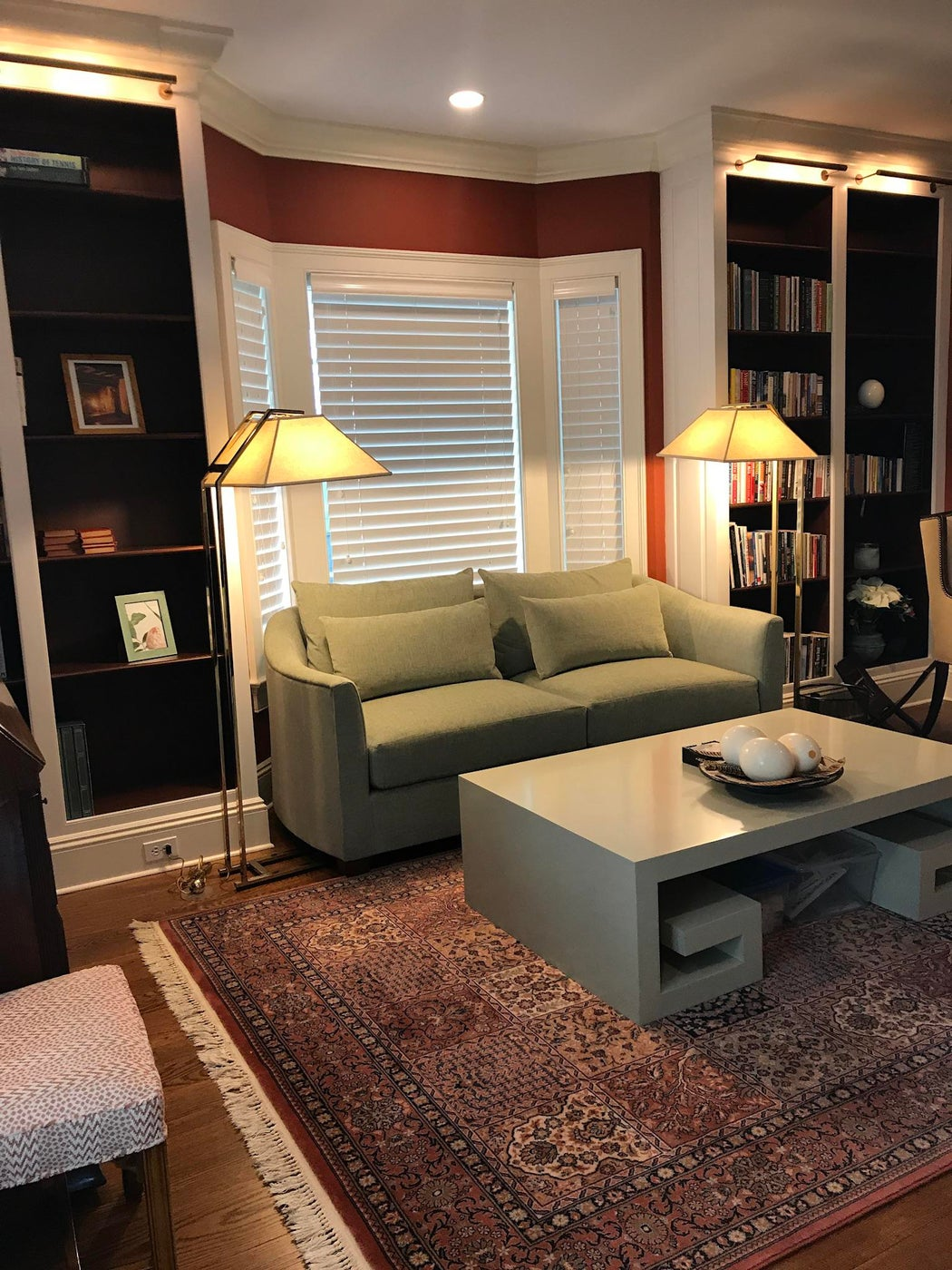 The Study. Retractable TV over fireplace and custom sofa by Kravet.