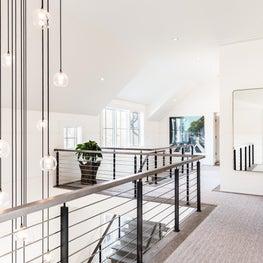 Upstairs hallway with custom cascading chandeleir