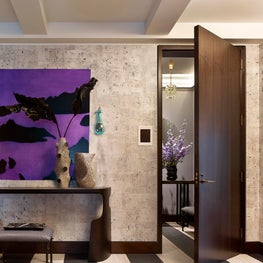 Graphic entrance gallery with custom wallpaper and colorful artwork