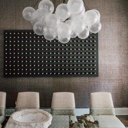 jewel tone dining room with modern art