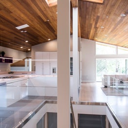 Portola Valley, contemporary renovation, glass railing between kitchen and den.