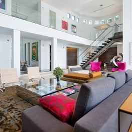 Pops of color enhance this modern neutral living room.
