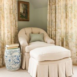 Master Bedroom in a coastal home with serene blue walls and linen drapery