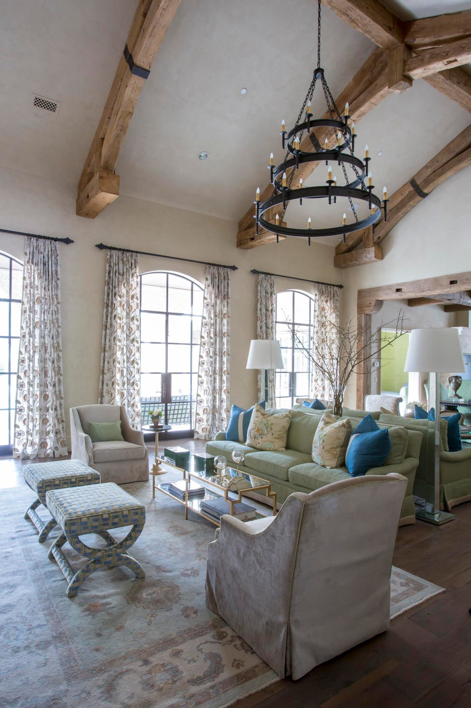 Large comfortable family room- reclaimed beams, custom lighting & pops of color